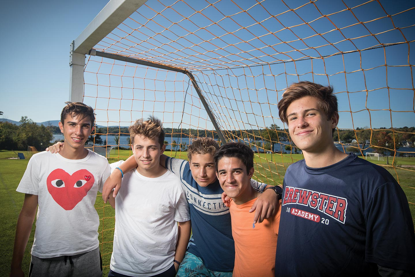 Boys posing in front of soccer net on Brewster field